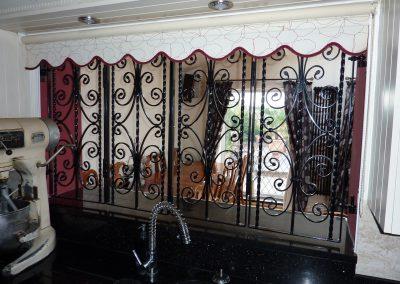 Bi-folding grilles
